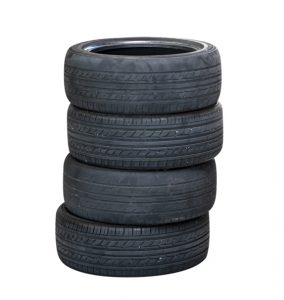 Old tires stacked, isolated on white