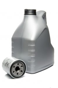 Gray Motor Oil Bottle and Engine Oil Filter